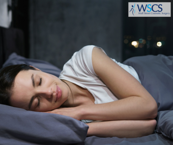 A woman comfortably resting in her bed on her side